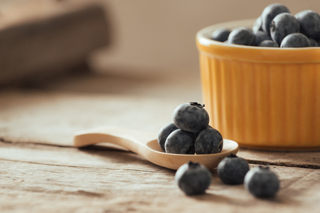 Fresh blueberries on a old wooden table