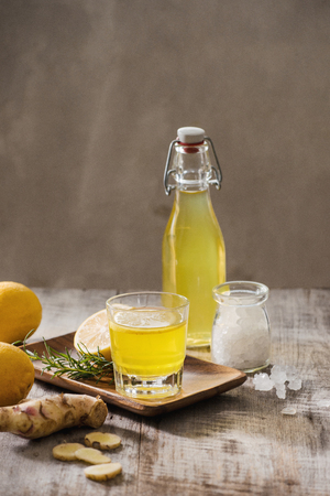 Homemade lemon and ginger organic probiotic drink, copy space. Stock Photo