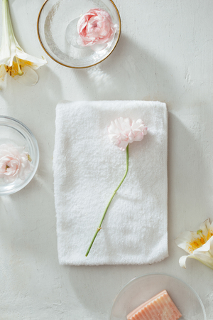 Spa setting with flowers, towel and soap on white background 版權商用圖片