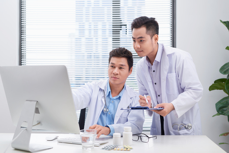 Two doctors discussing a patients medical records