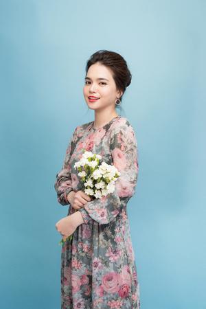 Lovely girl holds flowers bouquet