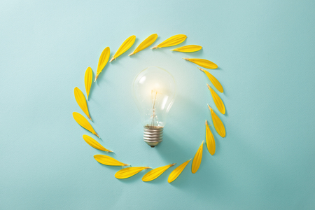 Saving energy with light bulb on the blue background