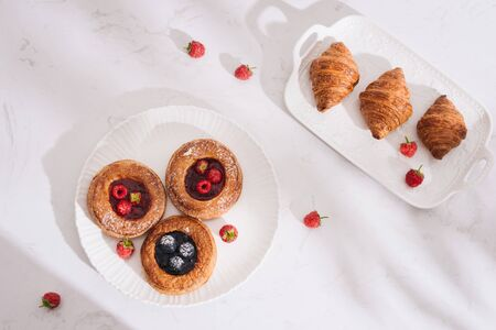 Homemade puff pastry with raspberries. Sweet tasty dessert. decorated with powdered sugar Stock Photo