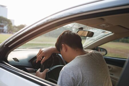Illness, exhausted, disease, tired for overworked concept. Asian businessman having headache from migraine while he driving car. Archivio Fotografico