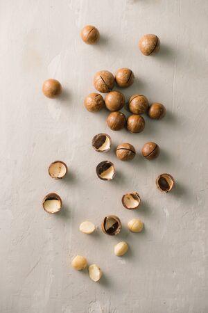 Superfood. Organic macadamia nut on stone background. Фото со стока