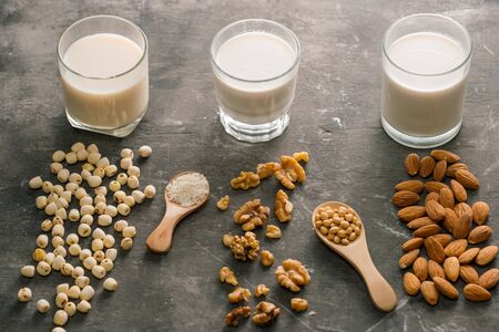 Glasses of milk: Almond, soy, walnut. Top view.