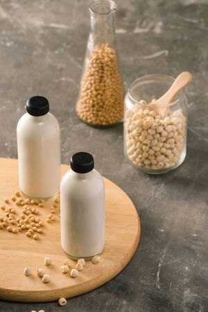 Bottle of lotus seed milk and soy milk on table.