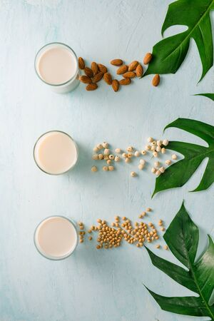 Glasses of milk: Almond, soy and lotus seed. Top view.