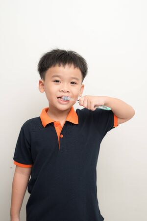 Handsome Young Boy Brushing Teeth Stock Photo