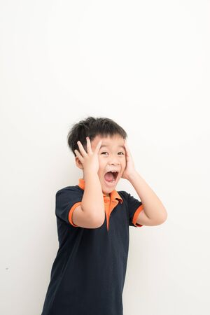 Cute little boy covering ears with hands, on white background Stock Photo