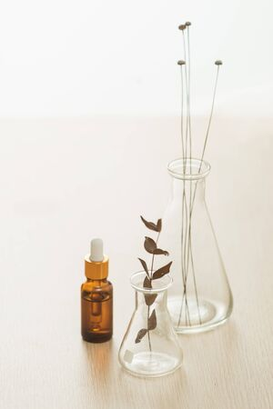 Cosmetic bottle stock images. Brown cosmetic bottle with batcher. Vials on a white background