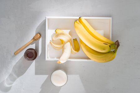 a sliced banana in a bowl on wooden background