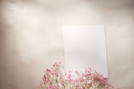 Spring morning concept. Flat-lay of flowers and card over background, top view with space for your text 写真素材