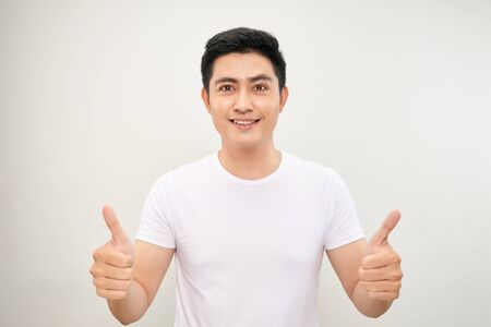 young asian man showing two thumbs up sign Stockfoto