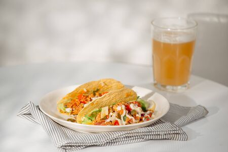 Authentic mexican tacos with beer. Mexican tacos with ground meat, beef, beans, onions and salsa Stock Photo