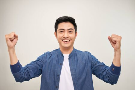 Cool asian man winner sign Stock fotó