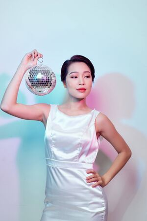 stylish young woman with a mirror ball Stockfoto