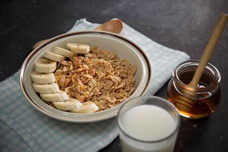 Tasty and healthy breakfast: fruits, corn flakes, milk and honey. Reklamní fotografie