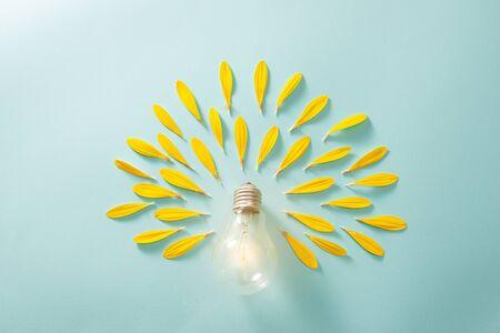 Saving energy with light bulb on the blue background Standard-Bild - 126710604