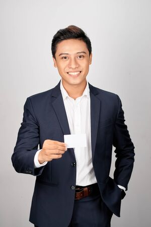 Asian Young Businessman hold with name card