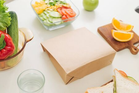 Top view of breakfast and brunch with vegetables, fruits and sandwich.