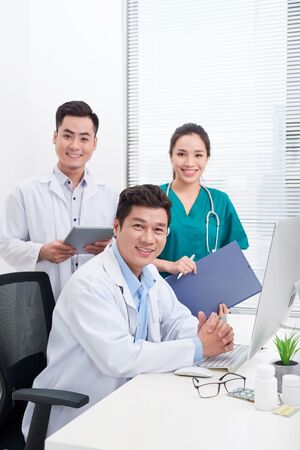 happy doctors at hospital office. Healthcare concept