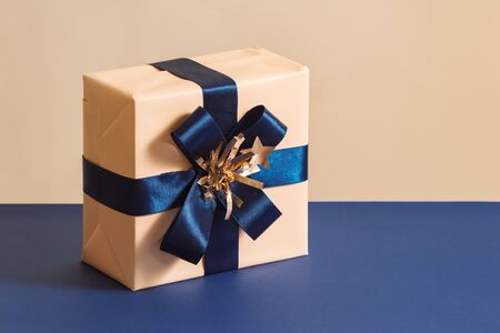 Christmas or Birthday box isolated on blue background Stock Photo