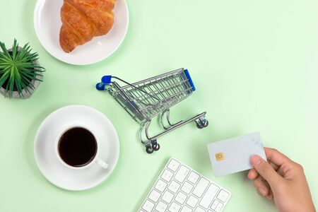 Shopping cart, keyboard, bank card and dessert top view copyspace Stock fotó
