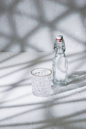 Glass bottle of water with drinking glass Banco de Imagens