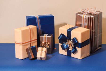 Christmas wrapped gift boxes on blue background