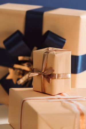 Gold and blue boxes on table closed up. Chrismas gifts
