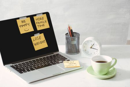 cropped image of woman holding paper sticker with word ideas near laptop Stock Photo