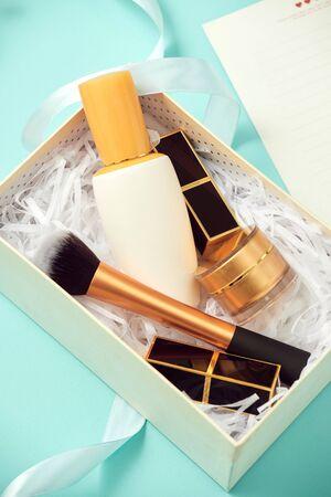 Set of make up cosmetics isolated on blue background Stock fotó