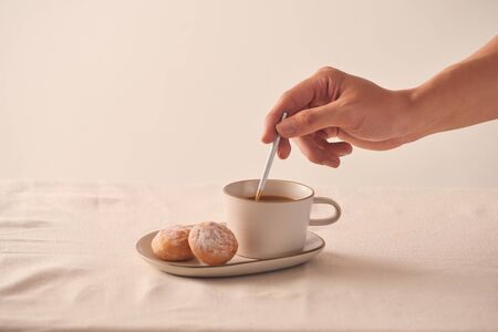 Morning coffee cup and sweet donut on white background Banco de Imagens