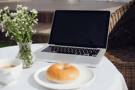Laptop, bread and cafe in coffee shop 写真素材