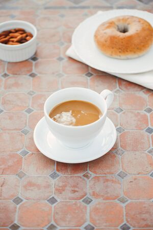 cup of coffee with bread on table in the morning with sunlight, breakfast