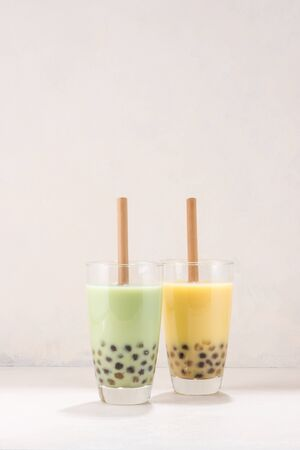 Variety of homemade bubble tea boba tea with tapioca pearls on white background