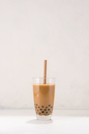 Chocolate Bubble Tea glasses with drink straw on white background. Stock Photo