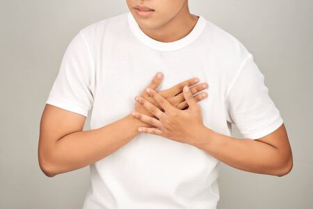 Asian man having tight chest from heart attack, white background , Sick person concept Stockfoto