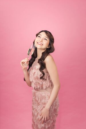 Portrait of a beautiful asian woman with glass of champagne.