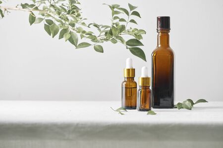 Bottles with aroma oil, medicines on wooden background. Selective focus,horizontal.