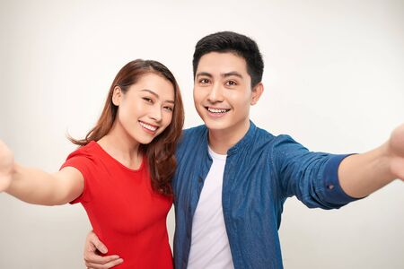 Young couple take selfie on white background Stock Photo