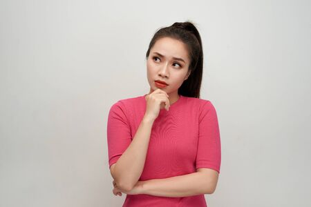 Portrait of beautiful cute young woman about new idea and looking at something