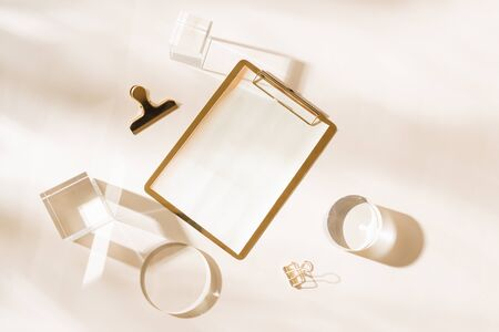 Knolling grid flatlay scene, white planner and gold stationery accessories, on a white desk background Reklamní fotografie