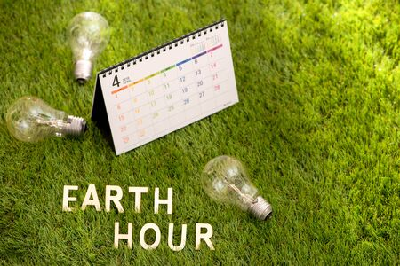 Letter happy earth day concept on green grass