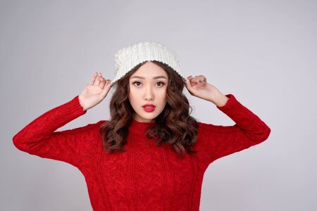 Portrait of beauty winter asian girl in knitted woolen clothing hat