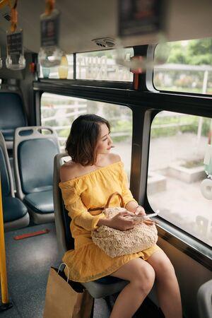 Asian woman looking view outside the bus window. Reklamní fotografie