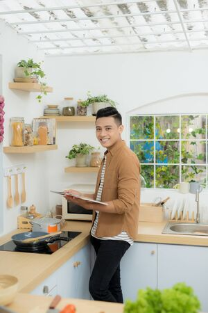 Smiling and confident chef standing in kitchen
