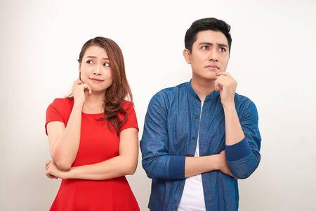 Depressed couple after quarrel on white background