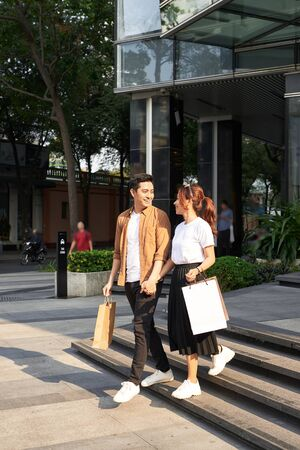 Happy Couple Shopping Mall Concept 写真素材